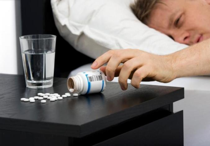 [man and sleeping pills]