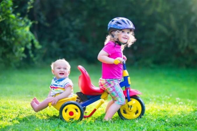 Siblings on a bike