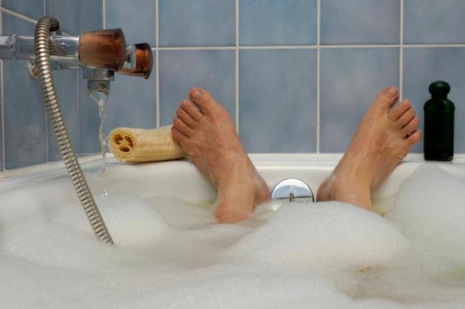 Feet of someone having a bath.